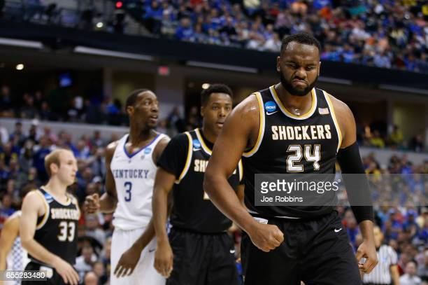 Shaquille Morris of the Wichita State Shockers reacts after blocking a shot by De'Aaron Fox of the Kentucky Wildcats in the first half during the...