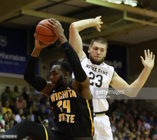 Shaquille Morris of the Wichita State Shockers scans a rebound in front of Martinas Geben of the Notre Dame Fighting Irish during the first half of...