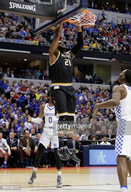 Shaquille Morris of the Wichita State Shockers shoots against Edrice Adebayo and De'Aaron Fox of the Kentucky Wildcats in the first half during the...