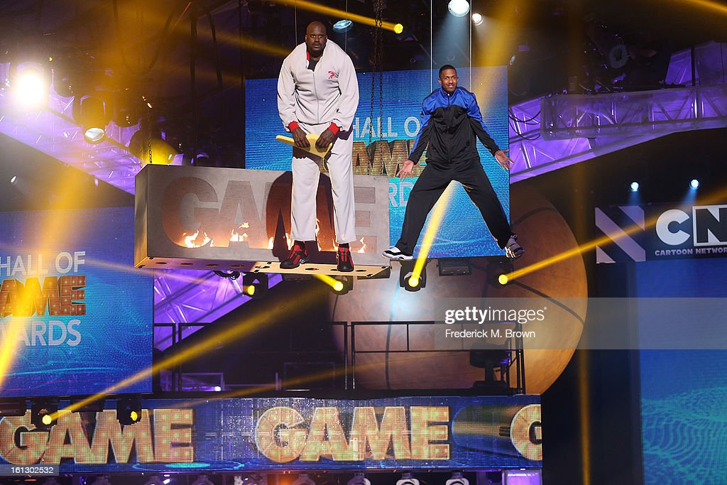 Shaquille O' Neal (L) and <a gi-track='captionPersonalityLinkClicked' href=/galleries/search?phrase=Nick+Cannon&family=editorial&specificpeople=202208 ng-click='$event.stopPropagation()'>Nick Cannon</a> perform during the 3rd Annual Cartoon Network's 'Hall Of Fame' Awards at the Barker Hangar on February 9, 2013 in Santa Monica, California.
