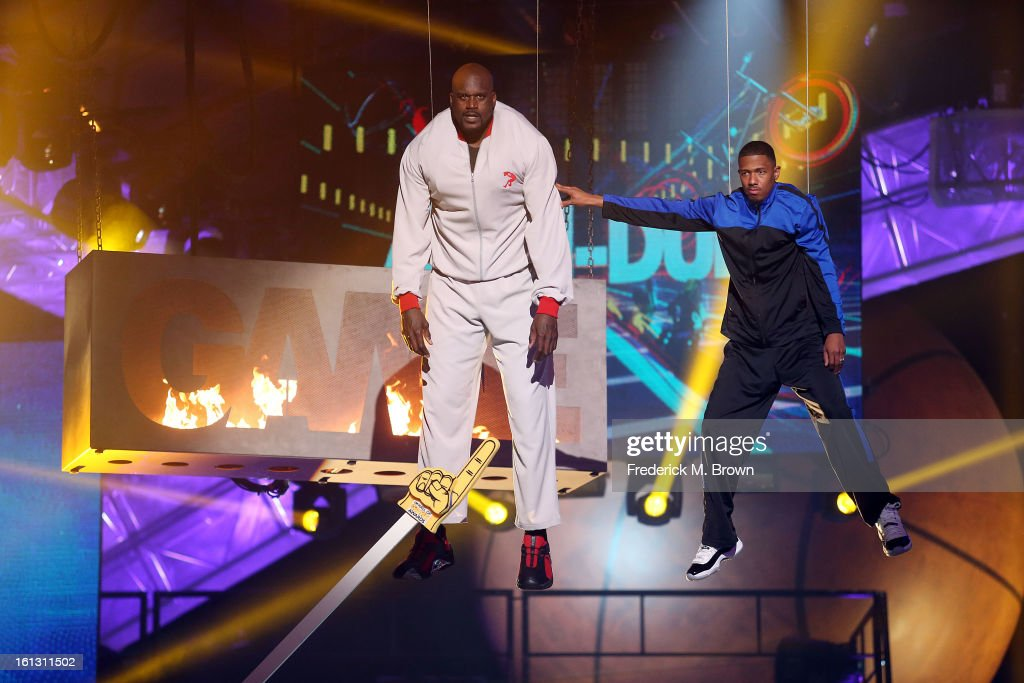 Shaquille O' Neal (L) and <a gi-track='captionPersonalityLinkClicked' href=/galleries/search?phrase=Nick+Cannon&family=editorial&specificpeople=202208 ng-click='$event.stopPropagation()'>Nick Cannon</a> perform during the 3rd Annual Cartoon Network's 'Hall Of Fame' Awards at the Barker Hangar, Santa Monica Airport, on February 9, 2013 in Santa Monica, California.