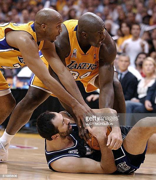 Shaquille O'NeaL and Brian Shaw of the Los Angeles Lakers try to wrestle the ball away from Vlade Divac of the Sacramento Kings during 2nd quarter...