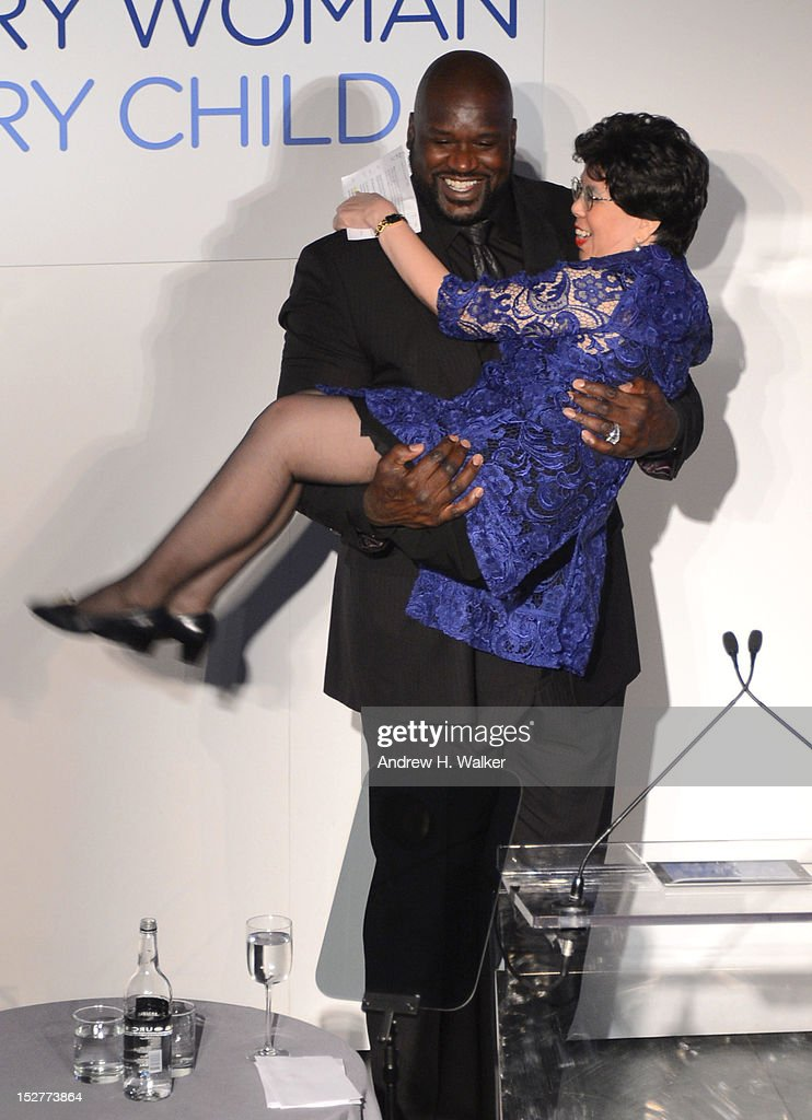 Shaquille O'Neal and Director-General of the World Health Organization Dr. Margaret Chan pose onstage at the United Nations Every Woman Every Child Dinner 2012 on September 25, 2012 in New York, United States.