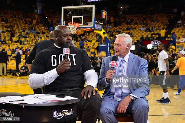 Shaquille O'Neal and Jerry West talks on NBATV prior to the game of the Cleveland Cavaliers against the Golden State Warriors during game two of the...