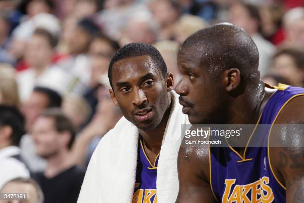 Shaquille O'Neal and Kobe Bryant of the Los Angeles Lakers sit on the bench during the game against the Portland Trail Blazers at the Rose Garden on...