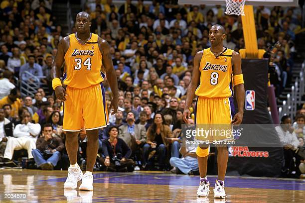 Shaquille O'Neal and Kobe Bryant of the Los Angeles Lakers stand on the court in Game Three of the Western Conference Semifinals against the San...