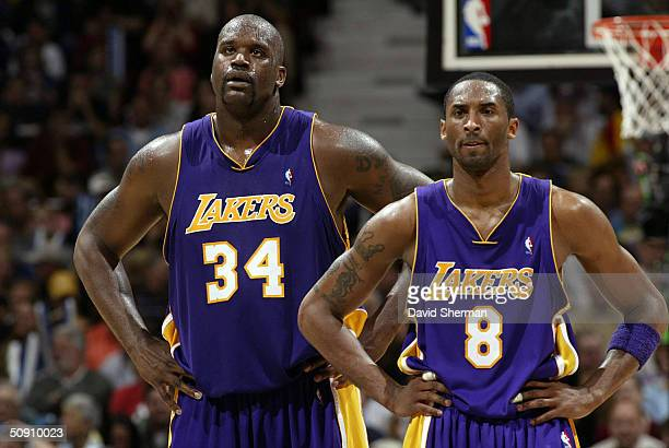 Shaquille O'Neal and Kobe Bryant of the Los Angeles Lakers stand on the court while playing againt the Minnesota Timberwolves in Game Five of the...
