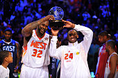 Shaquille O'Neal and Kobe Bryant of the Western Conference hold up the MVP trophy as they were named coMVP's at the 58th NBA AllStar Game part of...