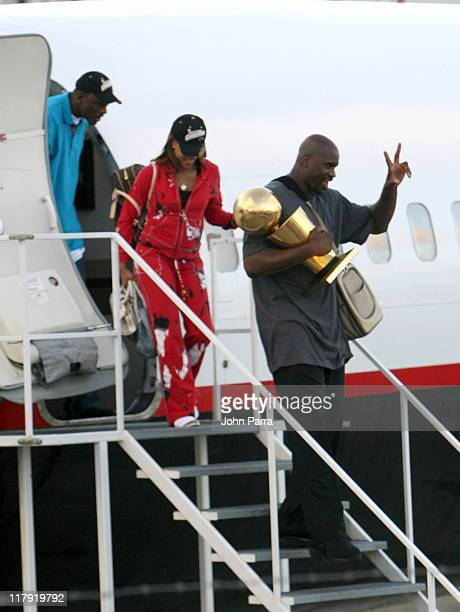 Shaquille O'Neal and Shaunie O'Neal arriving in Miami holding Larry O'Brien Championship trophy after winning the NBA Championship game the Heat beat...