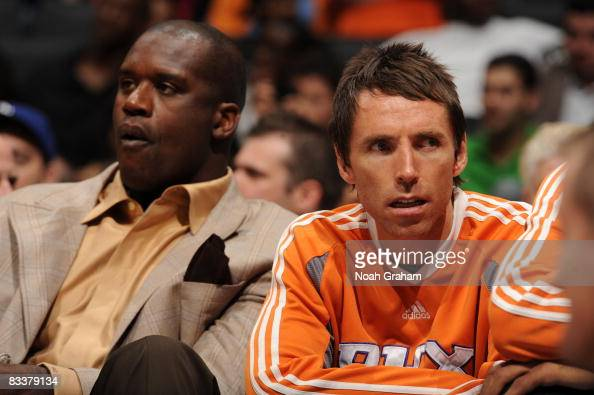 Shaquille O'Neal and Steve Nash of the Phoenix Suns sit on the bench during the game against the Los Angeles Clippers at Staples Center on October 21...