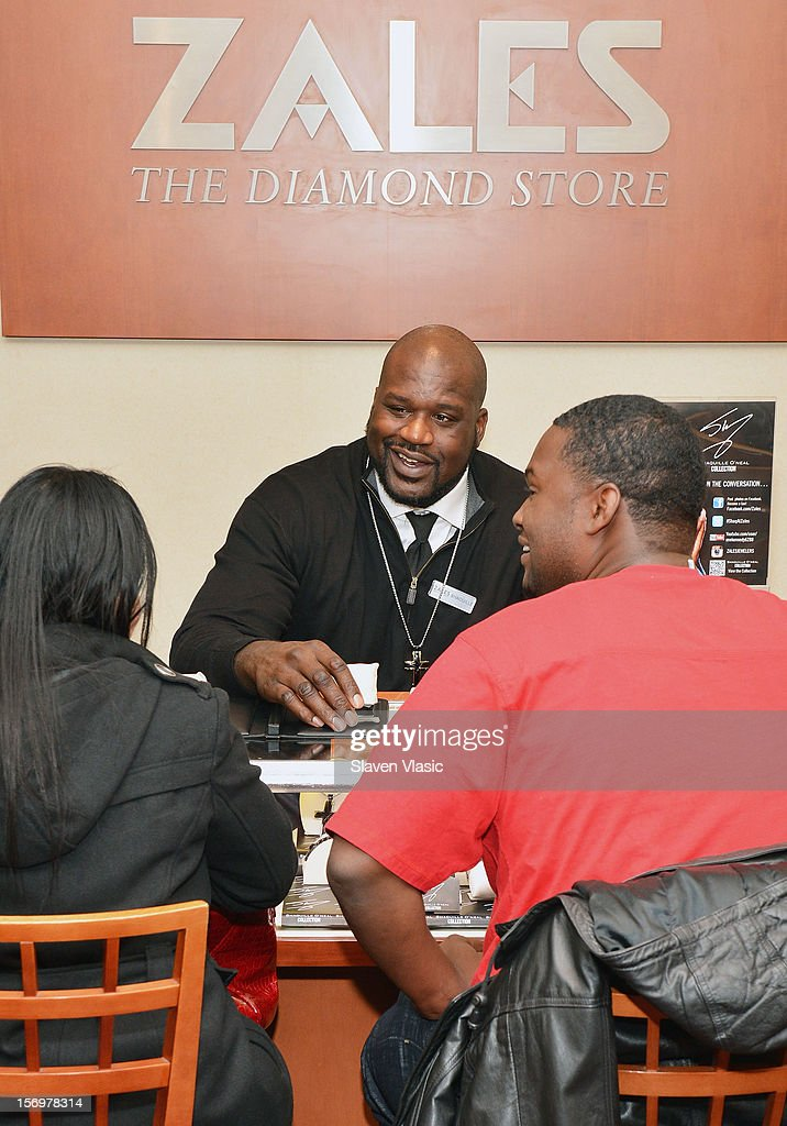 <a gi-track='captionPersonalityLinkClicked' href=/galleries/search?phrase=Shaquille+O%27Neal&family=editorial&specificpeople=201463 ng-click='$event.stopPropagation()'>Shaquille O'Neal</a> celebrates launch of his new men's jewelry line with Zales, by helping customers from behind the counter, on November 26, 2012 in New York City.