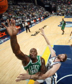 Shaquille O'Neal of the Boston Celtics rebounds against Marc Gasol of the Memphis Grizzlies on November 13 2010 at FedExForum in Memphis Tennessee...