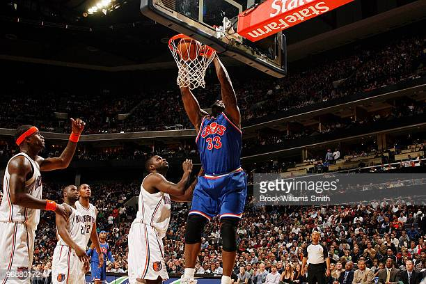 Shaquille O'Neal of the Cleveland Cavaliers blocks against DeSagana Diop of the Charlotte Bobcats on February 19 2010 at the Time Warner Cable Arena...