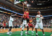 Shaquille O'Neal of the Cleveland Cavaliers dunks the ball against Kendrick Perkins of the Boston Celtics in Game Three of the Eastern Conference...