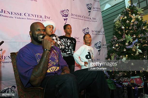 Shaquille O'Neal of the Cleveland Cavaliers hands out gifts to kids as ShaqAClaus and signs autographs on December 24 2009 at Challengers Boys Girls...