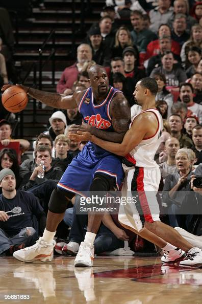 Shaquille O'Neal of the Cleveland Cavaliers looks for an opening around Juwan Howard of the Portland Trail Blazers during a game on January 10 2009...