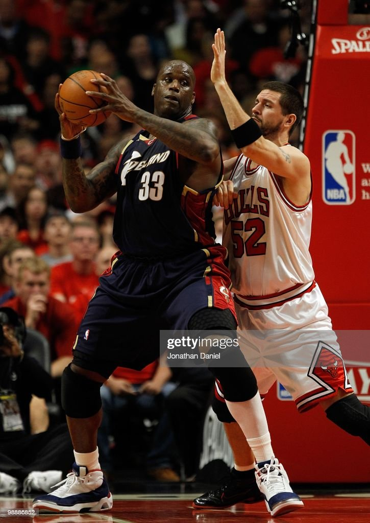 Shaquille O'Neal of the Cleveland Cavaliers moves against Brad Miller of the Chicago Bulls in Game Three of the Eastern Conference Quarterfinals...
