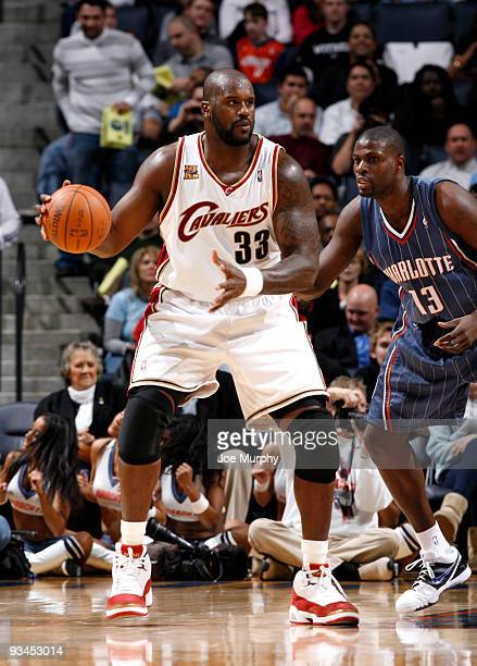 Shaquille O'Neal of the Cleveland Cavaliers posts up against Nazr Mohammed of the Charlotte Bobcats on November 27 2009 at Time Warner Cable Arena in...