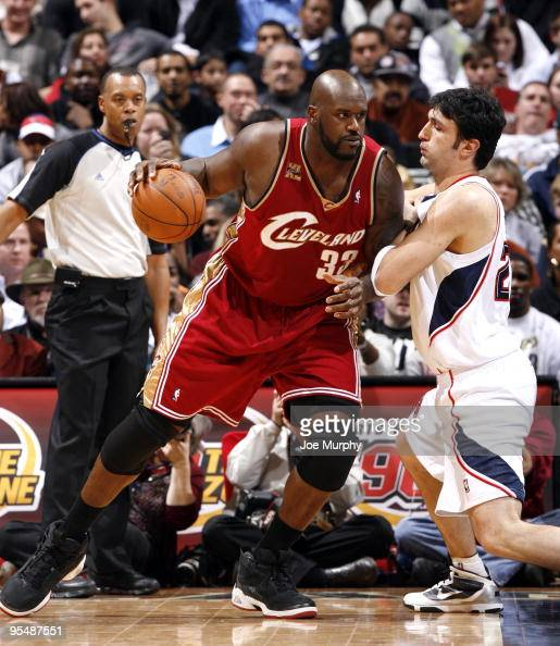 Shaquille O'Neal of the Cleveland Cavaliers posts up against Zaza Pachulia of the Atlanta Hawks on December 29 2009 at Philips Arena in Atlanta...