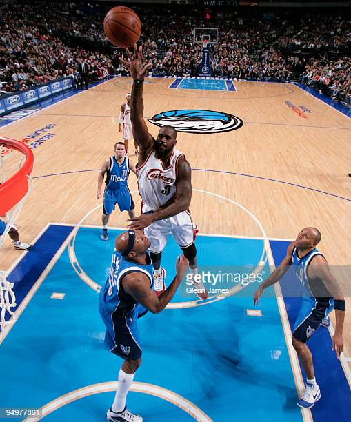 Shaquille O'Neal of the Cleveland Cavaliers puts up a hook shot against Erick Dampier and Shawn Marion of the Dallas Mavericks during a game at the...