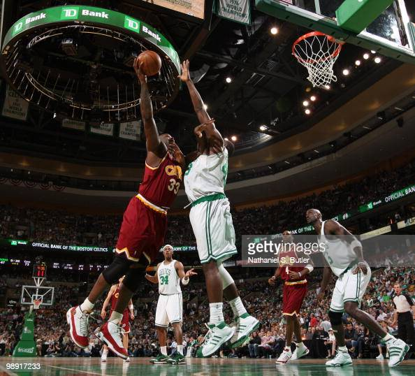 Shaquille O'Neal of the Cleveland Cavaliers shoots against Kendrick Perkins of the Boston Celtics in Game Three of the Eastern Conference Semifinals...
