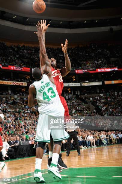 Shaquille O'Neal of the Cleveland Cavaliers shoots over Kendrick Perkins of the Boston Celtics in Game Six of the Eastern Conference Semifinals...