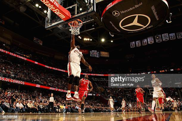 Shaquille O'Neal of the Cleveland Cavaliers slam dunks over Carl Landry of the Houston Rockets during the game on December 27 2009 at Quicken Loans...