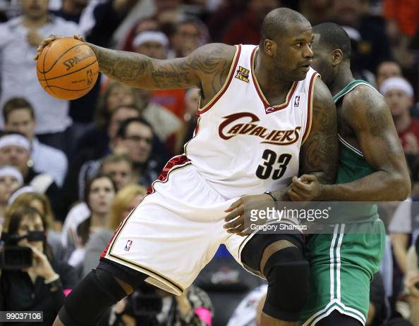 Shaquille O'Neal of the Cleveland Cavaliers tries to get around the defense of Kendrick Perkins of the Boston Celtics in Game Five of the Eastern...