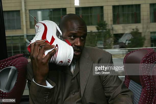 Shaquille O'Neal of the Eastern Conference AllStars talks on his sneaker phone as he rides the bus to the Arena for the 54th AllStar Game part of...