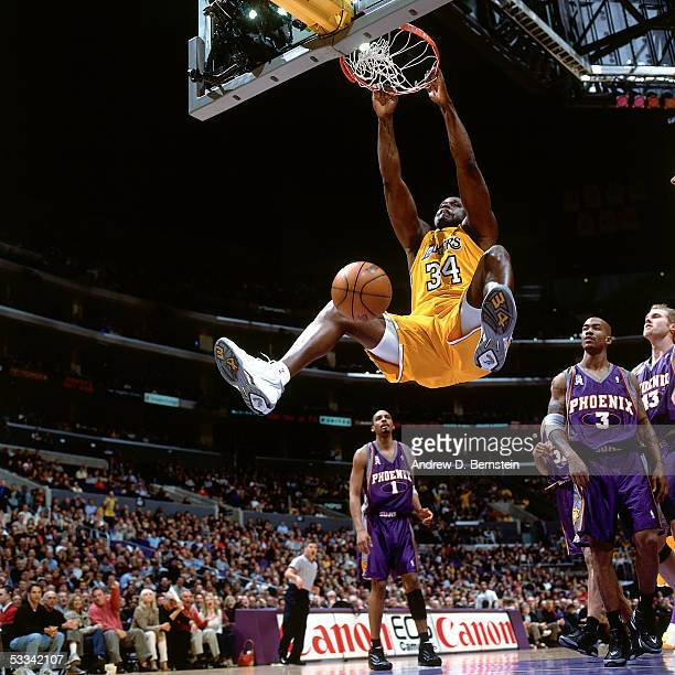 Shaquille O'Neal of the Los Angeles Lakers dunks against the Phoenix Suns during an NBA game circa 2004 at the Staples Center in Los Angeles...