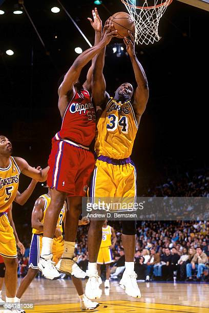 Shaquille O'Neal of the Los Angeles Lakers fights to rebound the ball against Lorenzen Wright of the Los Angeles Clippers during a game in 1999 at...