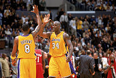 Shaquille O'Neal of the Los Angeles Lakers highfives teammate Kobe Bryant during the game against the Portland Trail Blazers at Staples Center on...