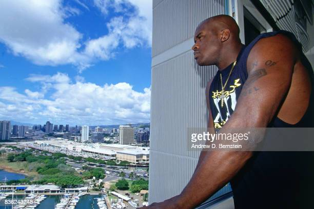 Shaquille O'Neal of the Los Angeles Lakers looks out his hotel room prior to a game against the Denver Nuggets during a preseason game on October 12...