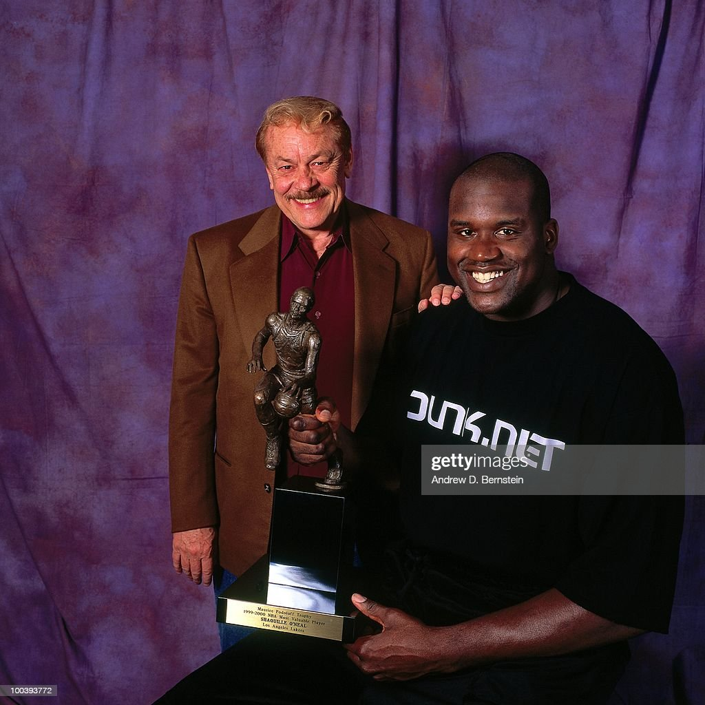 Shaquille O'Neal #34 of the Los Angeles Lakers poses with owner Jerry Buss for a portrait after winning the Most Valuable Player award on May 10, 2000 at the Staples Center in Los Angeles, California.