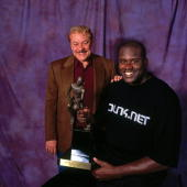 Shaquille O'Neal of the Los Angeles Lakers poses with owner Jerry Buss for a portrait after winning the Most Valuable Player award on May 10 2000 at...