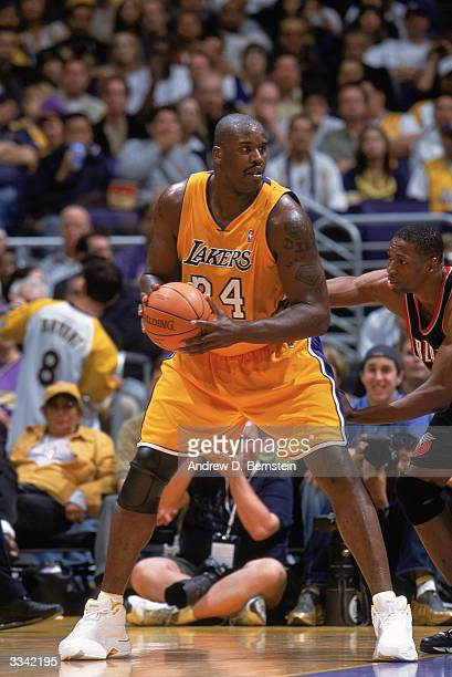 Shaquille O'Neal of the Los Angeles Lakers posts up during the game against the Portland Trail Blazers at Staples Center on April 6 2004 in Los...