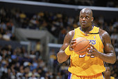 Shaquille O'Neal of the Los Angeles Lakers prepares to shoot a free throw during the NBA game against the Denver Nuggets at Staples Center on...