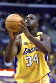 Shaquille O'Neal of the Los Angeles Lakers shoots a free throw against the Indiana Pacers 09 June during the first half of game 2 of the NBA Finals...