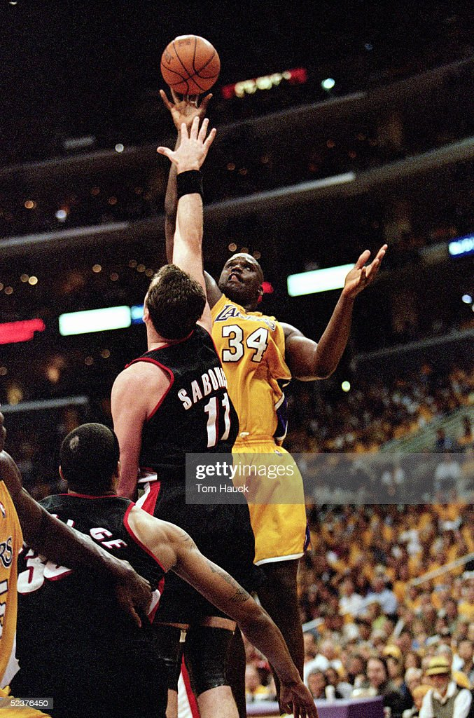 Shaquille O'Neal of the Los Angeles Lakers shoots a one handed jumper over Arvydas Sabonis of the Portland Trail Blazers during Game 7 of the Western...