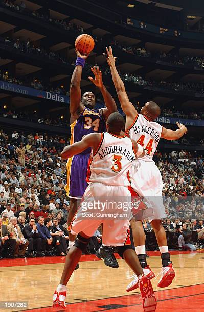 Shaquille O'Neal of the Los Angeles Lakers shoots over Shareef AbdurRahim and Alan Henderson of the Atlanta Hawks during the game at Philips Arena on...