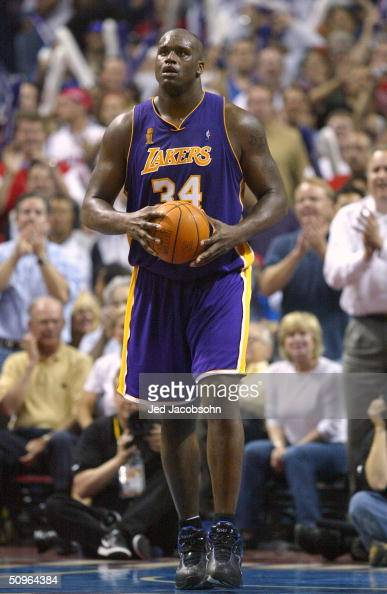 Shaquille O'Neal of the Los Angeles Lakers walks upcourt in the fourth quarter of game five of the 2004 NBA Finals against the Detroit Pistons on...
