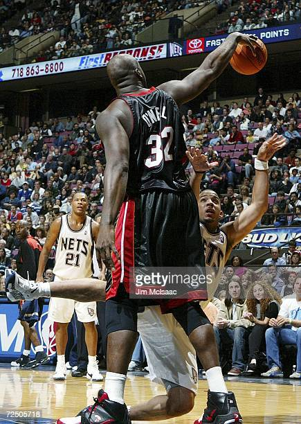 Shaquille O'Neal of the Miami Heat commits a foul against Marcus Williams of the New Jersey Nets during their game on November 10 2006 at Continental...