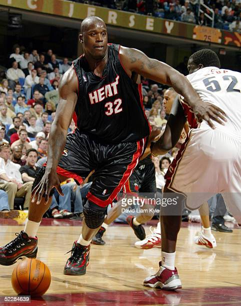 Shaquille O'Neal of the Miami Heat drives against DeSagana Diop of the Cleveland Cavaliers at Gund Arena on March 6 2005 in Cleveland Ohio NOTE TO...