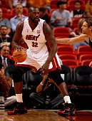 Shaquille O'Neal of the Miami Heat drops down the the post against Fabricio Oberto of the San Antonio Spurs at American Airlines Arena on October 23...