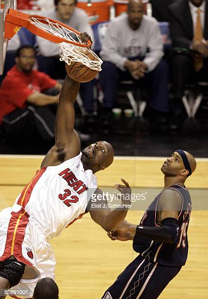 Shaquille O'Neal of the Miami Heat dunks over Vince Carter of the New Jersey Nets in Game one of the Eastern Conference Quarterfinals during the 2005...