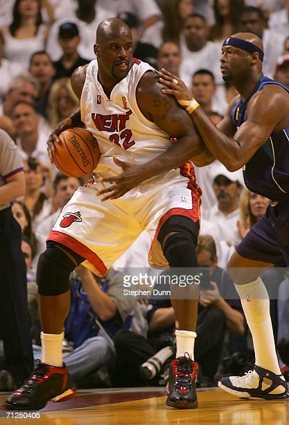 Shaquille O'Neal of the Miami Heat goes up against Erick Dampier of the Dallas Mavericks in game five of the 2006 NBA Finals on June 18 2006 at...
