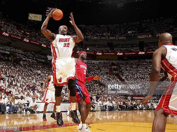 Shaquille O'Neal of the Miami Heat grabs a rebound against the Detroit Pistons in game six of the Eastern Conference Finals during the 2006 NBA...