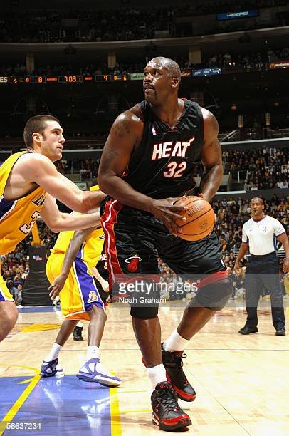 Shaquille O'Neal of the Miami Heat is defended by Chris Mihm of the Los Angeles Lakers during the game at Staples Center on January 16 2006 in Los...