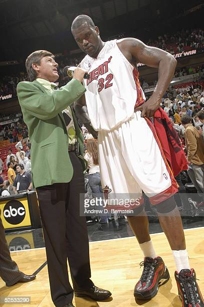 Shaquille O'Neal of the Miami Heat is interviewed by TNT announcer Craig Sager after the victory over the Los Angeles Lakers at American Airlines...