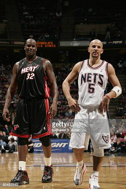 Shaquille O'Neal of the Miami Heat is near Jason Kidd of the New Jersey Nets during the game on March 3 2005 at the Continental Airlines Arena in...